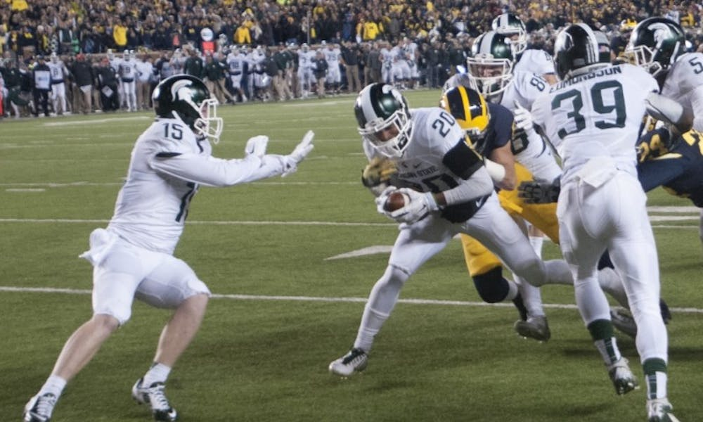 <p>Sophomore defensive back Jalen Watts-Jackson runs the ball for the game winning touchdown during the game against Michigan on Oct. 17, 2015 at Michigan Stadium. The Spartans defeated the Wolverines, 27-23.</p>