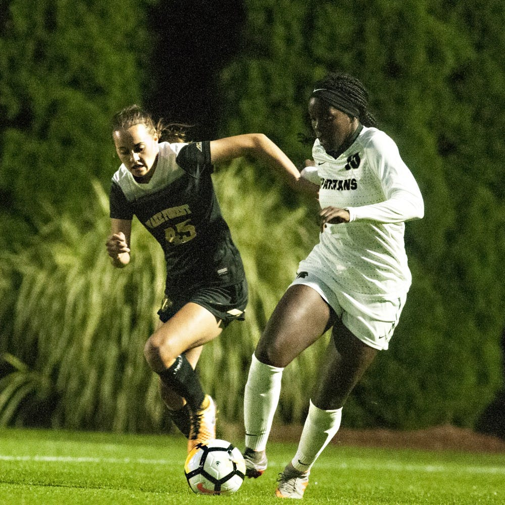<p>Senior forward Kristelle Yewah (10) dribbles the ball past Wake Forest forward Bri Carney (45) during the game against Wake Forest on Sept. 7, 2017 at DeMartin Stadium at Old College Field. The Spartans fell to the Demon Deacons , 4-1.&nbsp;</p>