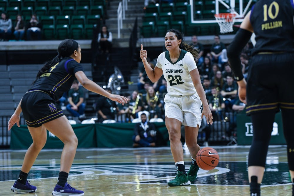<p>Freshman guard Moira Joiner (22) calls a play during a women's basketball game against Northwestern on Jan. 23 at the Breslin Center. The Spartans fell to the Wildcats 76-48.</p>