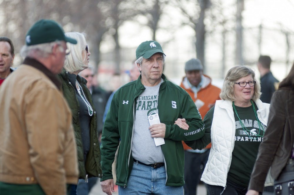 <p>From left, Escanaba residents and MSU alumni Chris and Denise Young walk with Grand Rapids residents and MSU alumni Jim and Gail Vidro Mar. 13, 2015, outside United Center in Chicago. The group of friends said they have attended every Big Ten Tournament since the first one in 1998. Kelsey Feldpausch/ The State News </p>