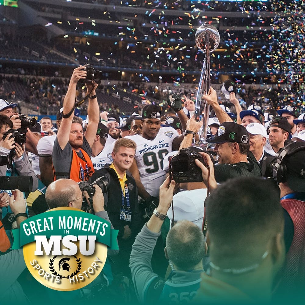 Head Coach Mark Dantonio holds the trophy and celebrates the win with his team Jan. 1, 2015, during the Cotton Bowl Classic football game against Baylor at AT&T Stadium in Arlington, Texas. The Spartans defeated the Bears and claimed the Cotton Bowl victory, 42-41. Photo by Erin Hampton. Design by Daena Faustino.