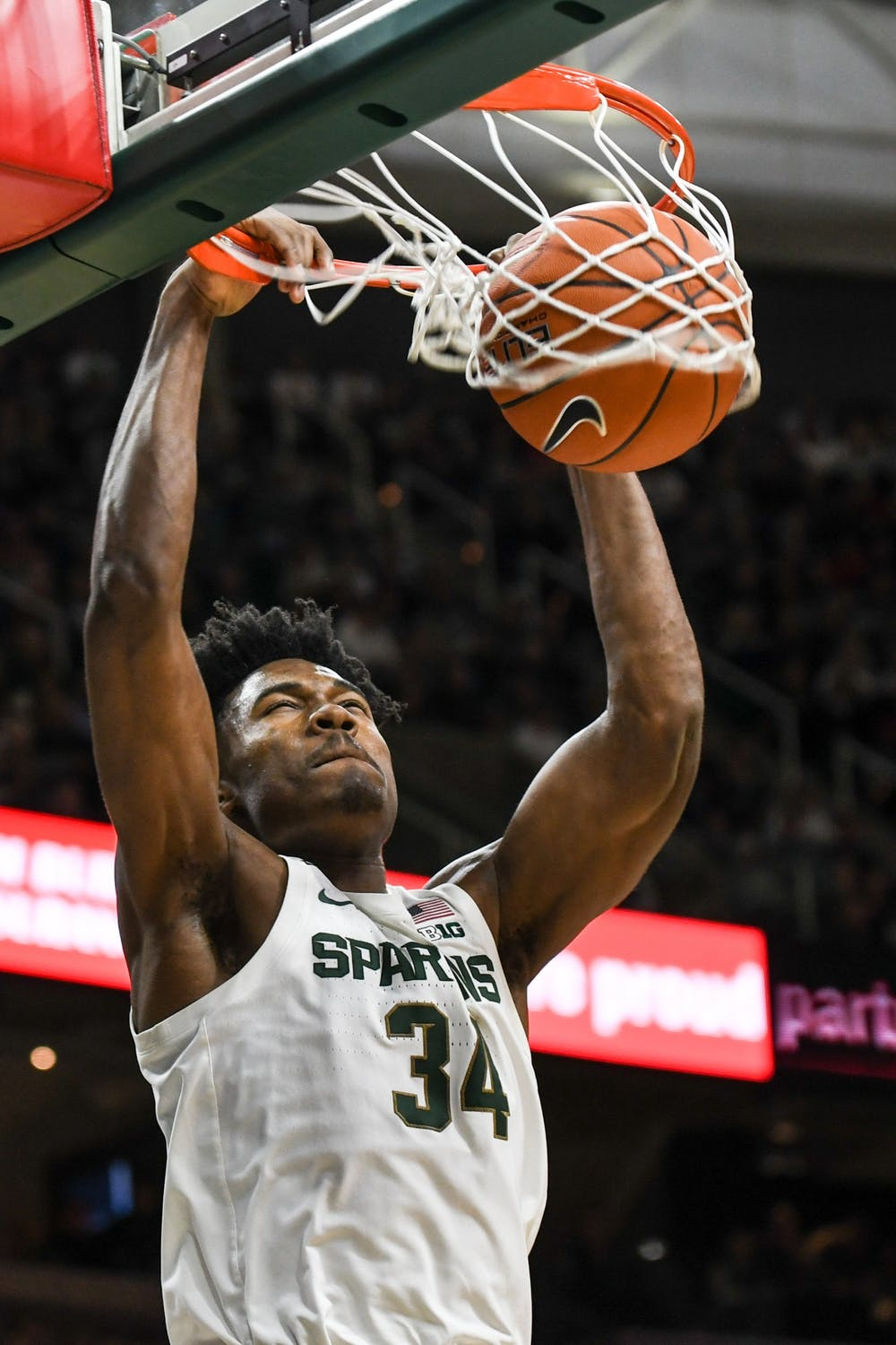 <p>Freshman forward Julius Marble (34) dunks during the game against Eastern Michigan on Dec. 21, 2019 at the Breslin Center. The Spartans defeated the Eagles, 101-48.</p>