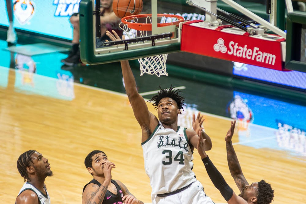 <p>Sophomore Julius Marble II sinks a second-chance layup during the first half of the Spartans&#x27; game against Penn State on Feb. 9, 2021.</p>