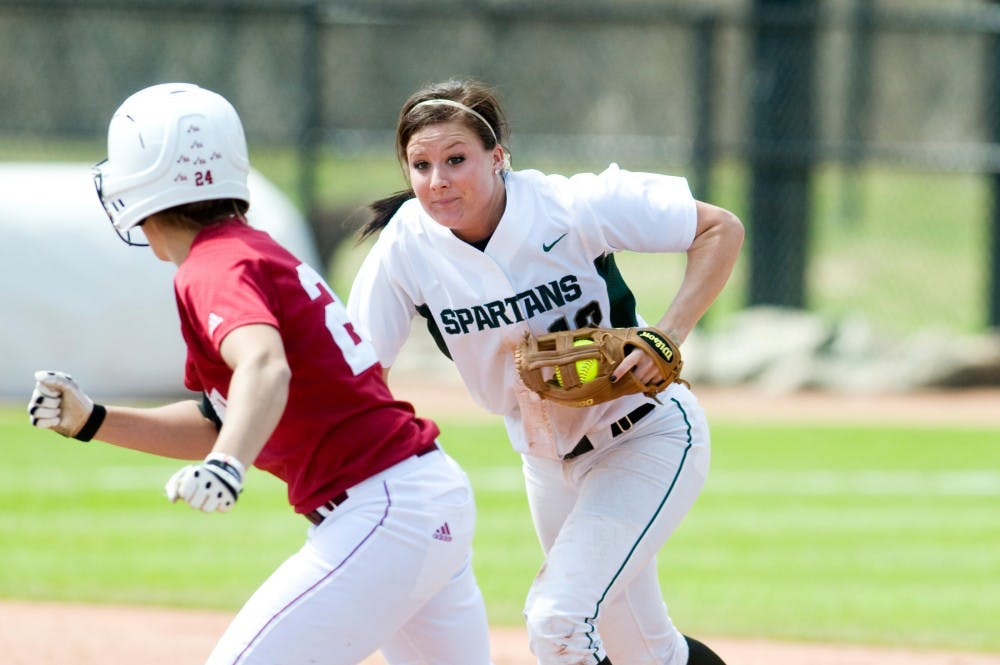 <p>Senior shortstop Lindsey Hansen chases down Indiana outfielder Heather Nelson after she found herself in a pickle between first and second base. The Spartans lost the April 23 game to Indiana 7-2. </p>