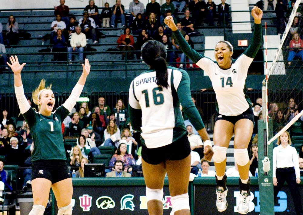 The Spartans celebrate after scoring a point against Purdue. The Spartans would eventually fall to the Boilermakers, 3-1, Saturday night at Jenison Field House. Justin Wan/The State News