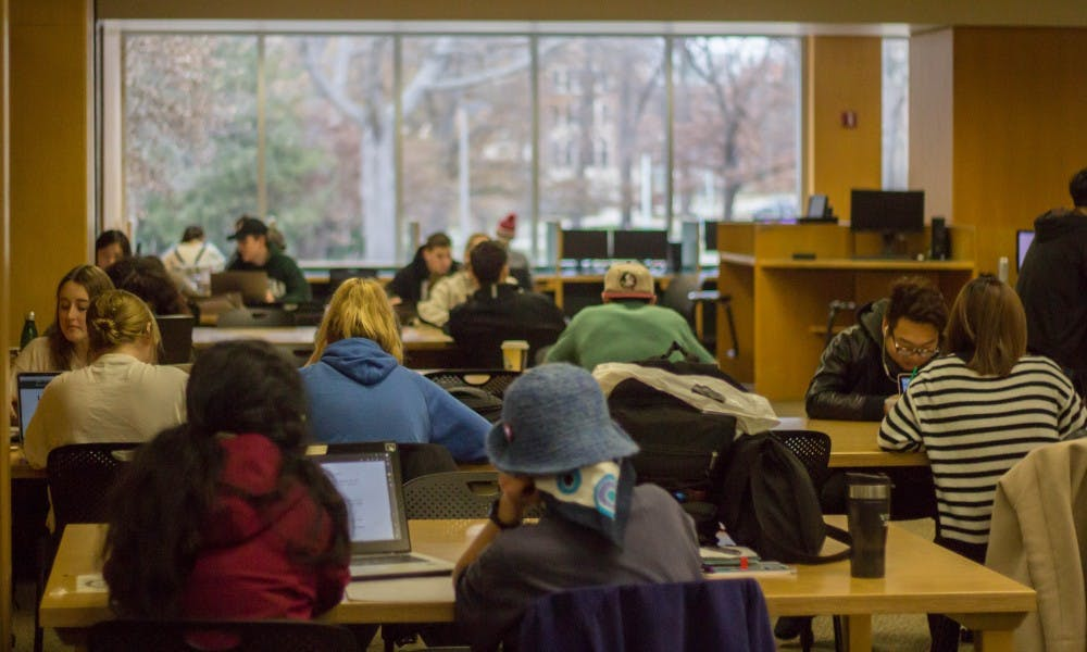 Students gather and study on Dec. 4, 2017, at the Main Library.