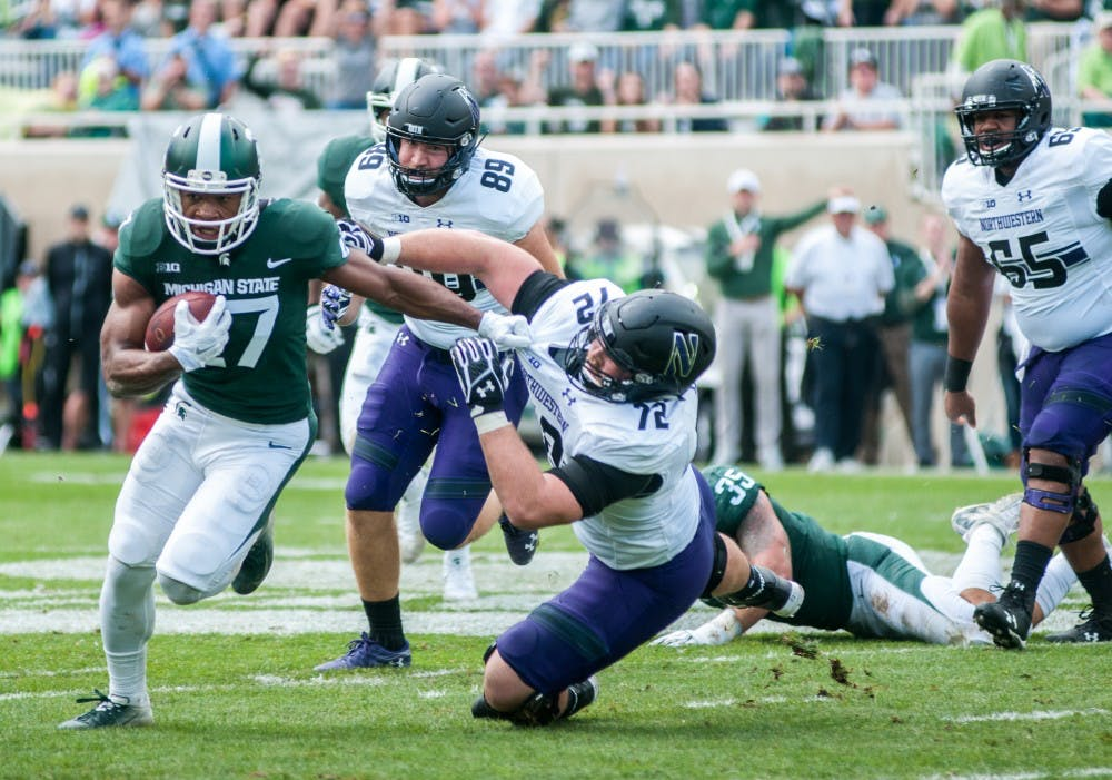 <p>Khari Willis (27) advances the ball after an interception during the game against Northwestern on Oct. 6, 2018 at Spartan Stadium. </p>