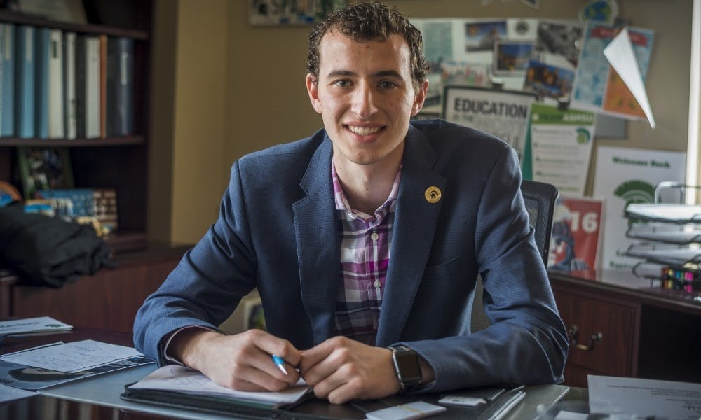 <p>International relations junior Lorenzo Santavicca poses for for a portrait on March 24, 2017 at Student Services. Santavicca was reelected to serve as ASMSU president on April 25.</p>