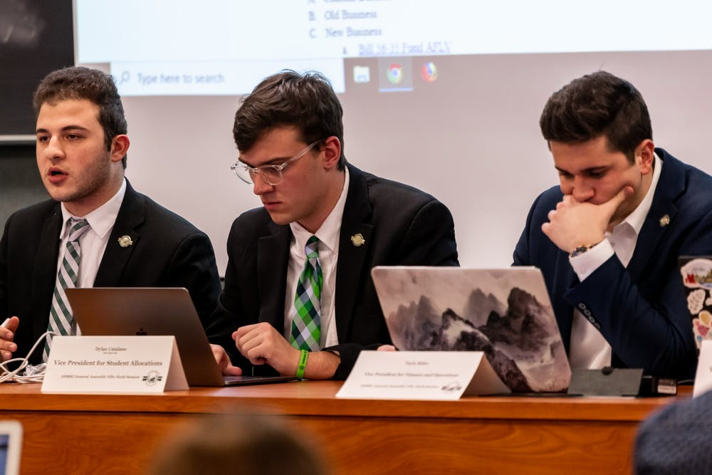 <p>ASMSU President Mario Kakos (left), Vice President for Student Allocations Dylan Catalano (center), and Vice President for Financial Operations Tayte Rider (right) at an ASMSU General Assembly meeting in the MSU International Center on Jan. 16, 2020.</p>