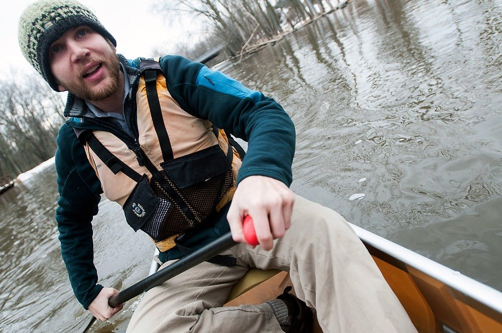 """<p>Alumnus Tim """"Boot"""" Muhichpaddles in a canoe March 20, 2014, on the Red Cedar River near Kruger Landing.  Baweja and his team plan to canoe the entire Mississippi River in less than 18 days this coming May.  Allison Brooks/The State News</p>"""