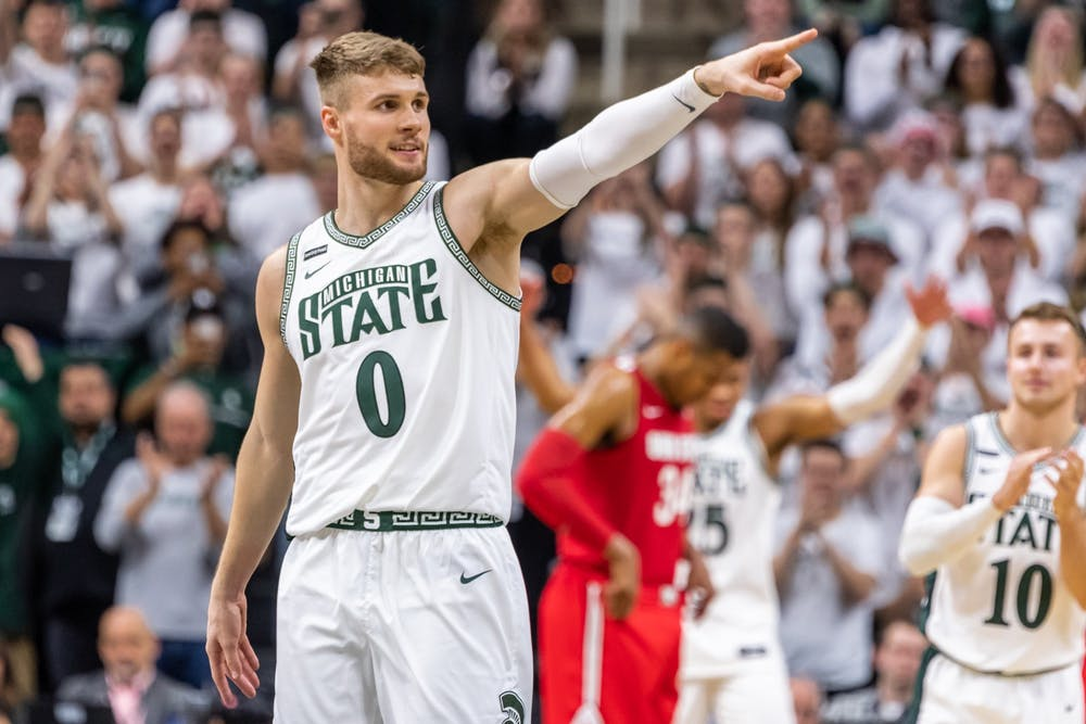 <p>Senior forward Kyle Ahrens is subbed out on his senior day against Ohio State. The Spartans defeated the Buckeyes, 80-69, on March 8, 2020 at the Breslin Student Events Center.</p>