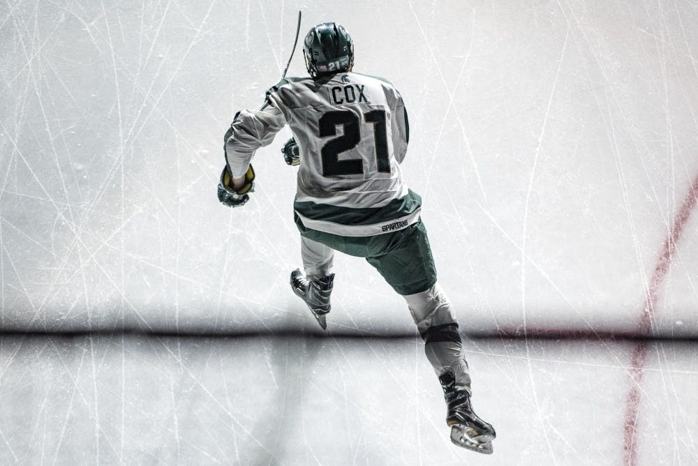<p>Senior forward Joe Cox (21) skates before the game against Penn State on Feb. 25, 2017 at Munn Ice Arena. The Spartans were defeated by the Nittany Lions, 4-1.</p>