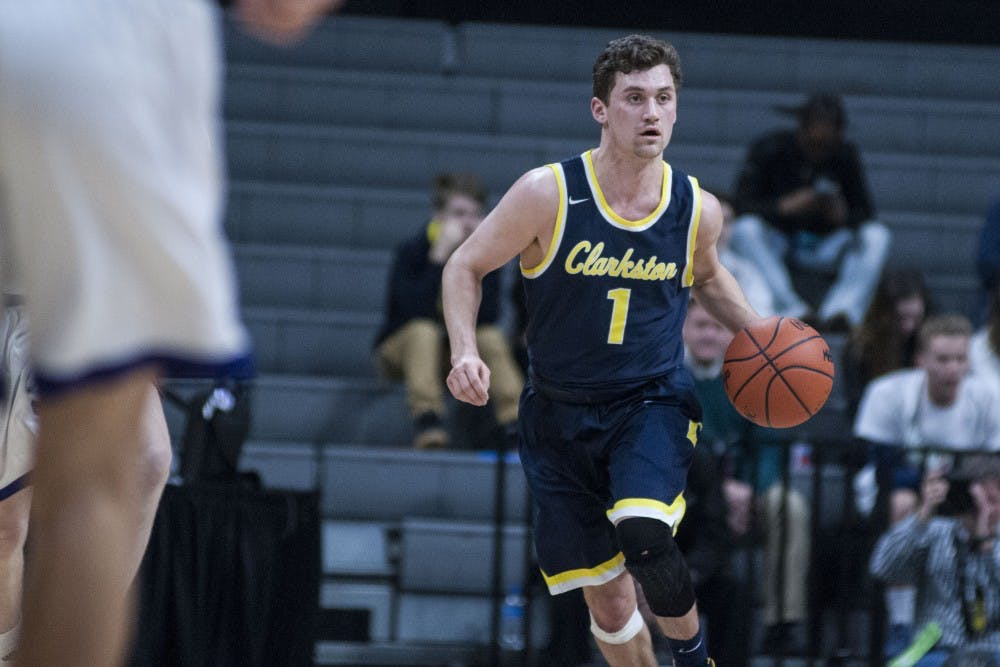 Clarkston guard Foster Loyer (1) brings the ball up the court during the MHSAA mens basketball class A semi-final game on March 23, 2018 at Breslin Center. The Wolves beat the Pilots, 72-49. (C.J. Weiss   The State News)
