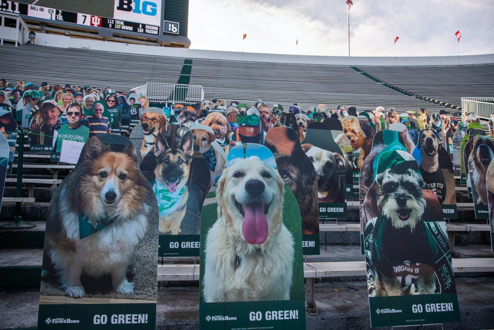 Spartan pets support the team from the south end of the stadium during a football game against Indiana University at Spartan Stadium on Nov. 14, 2020.