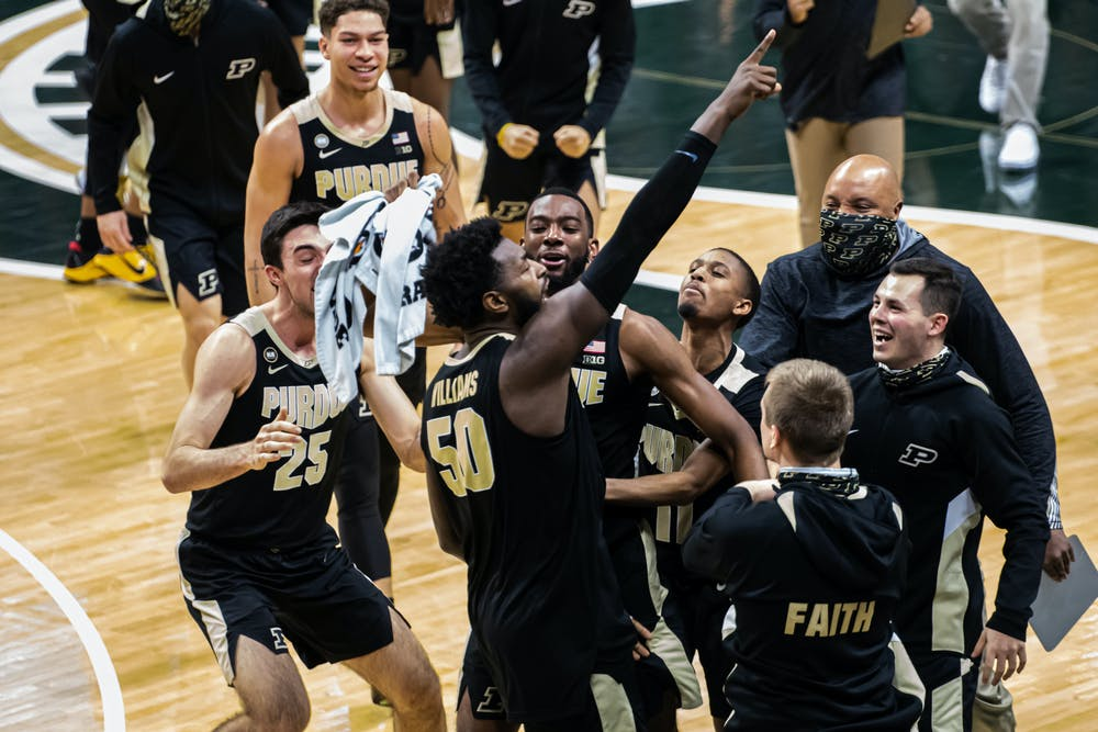 <p>Junior forward Trevion Williams points to the stands in celebration after scoring on the Boilermakers&#x27; last possession to help secure a comeback victory against the Spartans on Jan. 8, 2021.</p>