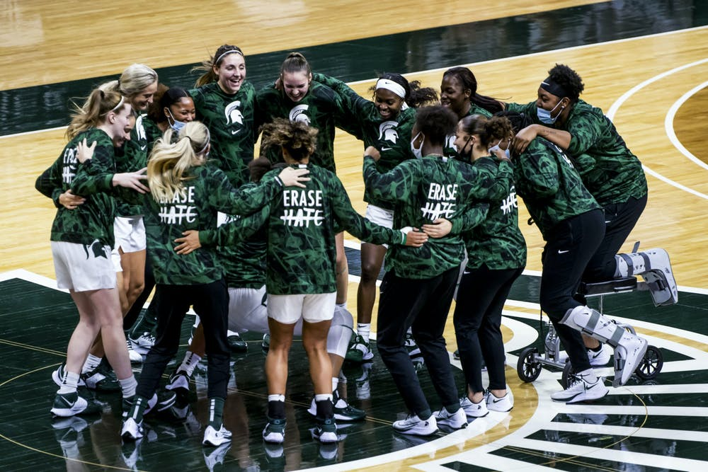 <p>The Michigan State University women&#x27;s basketball team huddles together before their first game against St. Francis PA on Nov. 27, 2020.</p>