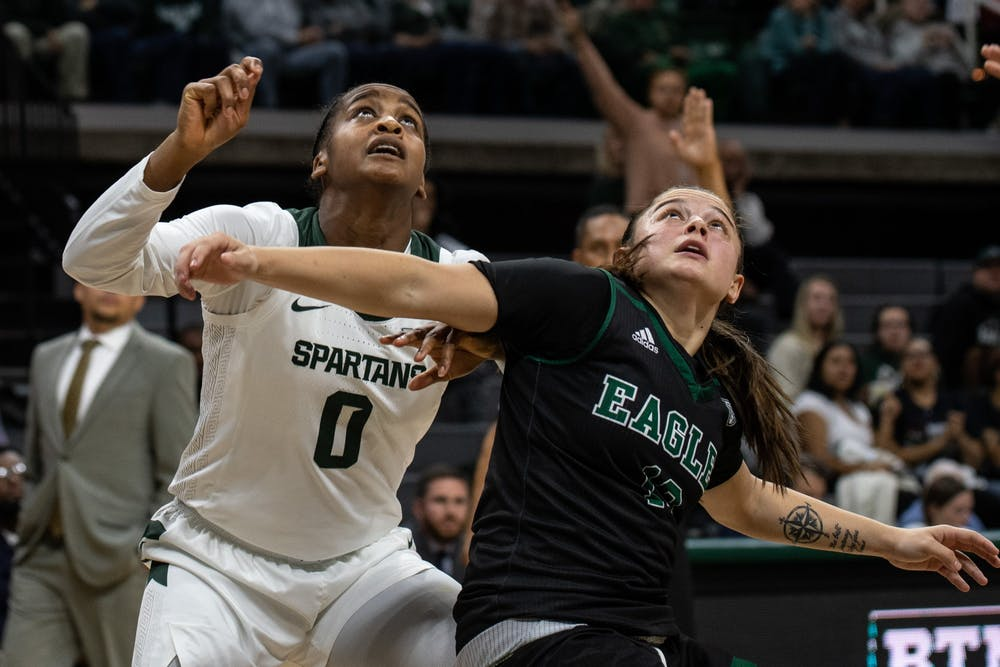 Redshirt senior guard Shay Colley (0) fights for a rebound during the game against Eastern Michigan Nov. 5, 2019 at the Breslin Center.