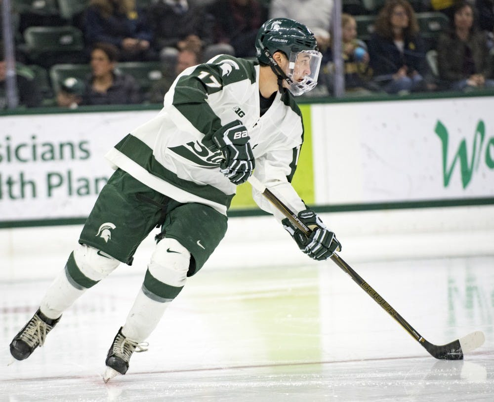 Freshman forward Taro Hirose (17) takes the puck down the rink during the second period of the game against Michigan on Jan. 21, 2017 at Munn Ice Arena. The Spartans were defeated by Wolverines, 2-3.