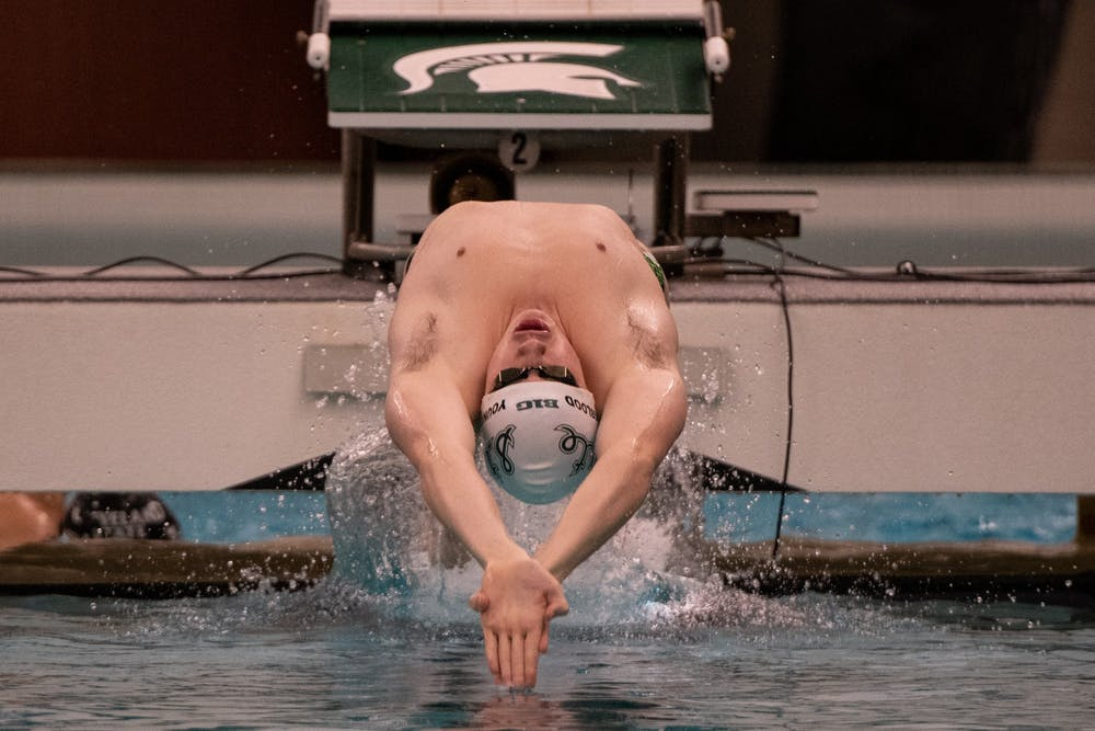 <p>Junior Weston Youngblood begins a race during the meet against Cleveland State on Jan. 24 at McCaffree Pool. The Spartans defeated the Vikings, 163.5-135.5.</p>