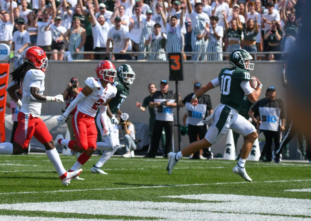 <p>Spartans quarterback Payton Thorne runs the ball into the end zone for the second touchdown for Michigan State, bringing the Spartans to 14-0 against the Penguins. Sept. 11, 2021.</p>
