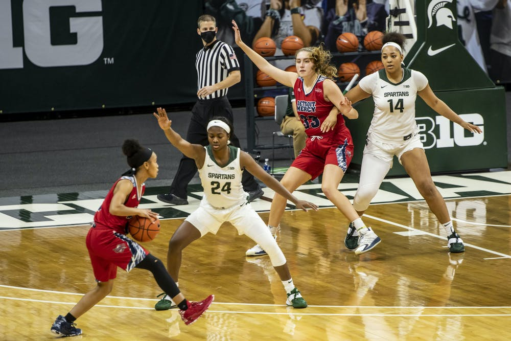 <p>MSU&#x27;s Nia Clouden (24) and Taiyier Parks (14) defend against Detroit Mercy on Dec. 02, 2020.</p>