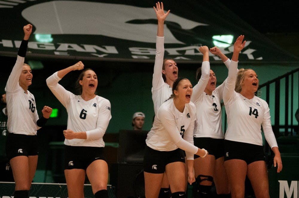 The Spartans celebrate from the sideline after the team scored a point during the game against Maryland on Oct. 8, 2016 at Jenison Field House.  The Spartans defeated the Terrapins, 3-1.