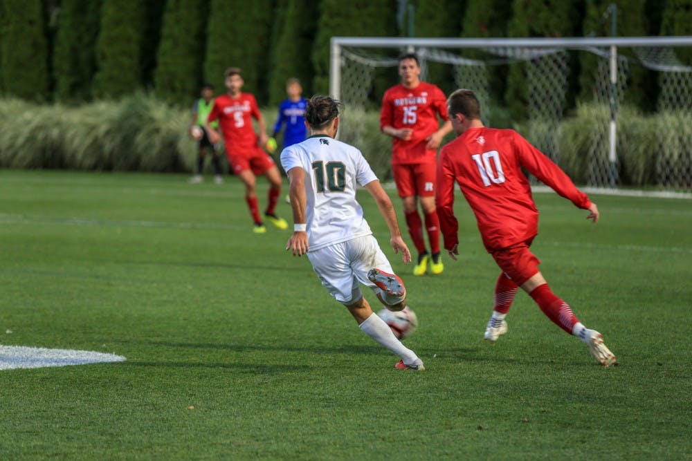 <p>Then-junior midfielder Giuseppe Barone (10) runs with Rutgers forward Brian Hawkins (10) during the game against Rutgers on Sept. 21, 2018. The Spartans defeated the Scarlet Knights, 2-1.</p>