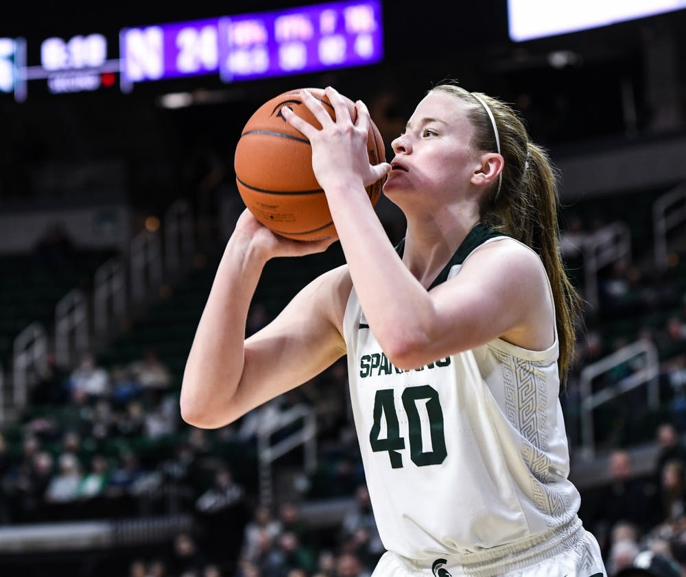 Julia Ayrault takes a shot during a women's basketball game against Northwestern on Jan. 23, 2020 at the Breslin Center.