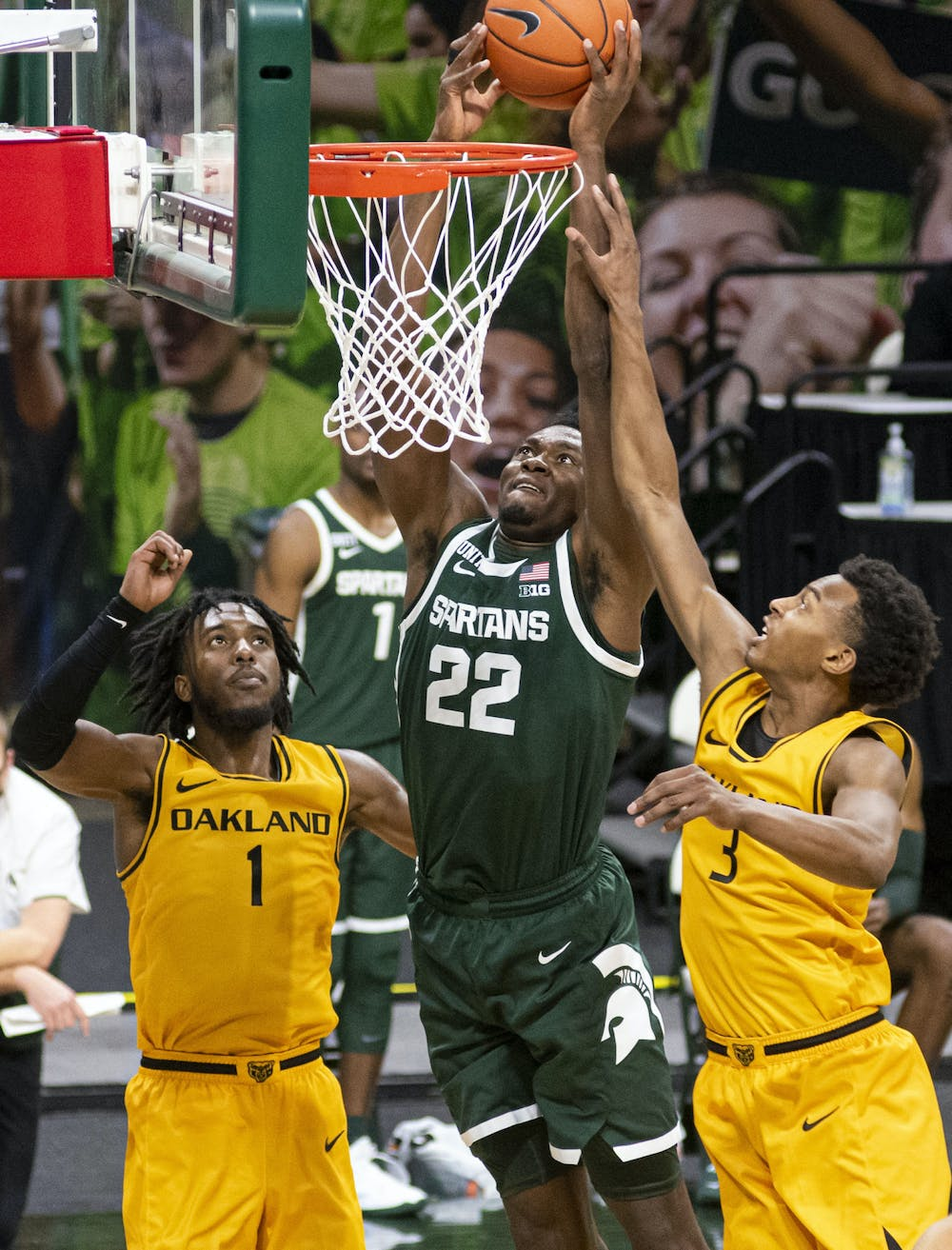 Freshman center Mady Sissoko (22) attempts to dunk on the Oakland net during the second half, but is unsuccessful. The Spartans came back after the first half to pull out a 109-91 win on Dec. 13, 2020.