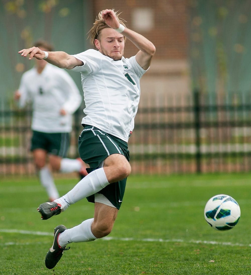 Sophomore defender Ryan Keener kicks the ball to teammates Oct. 28, 2012, at DeMartin Stadium at Old College Field. The Spartans won their game against the Indiana Hoosiers, 3-1. Natalie Kolb/The State News
