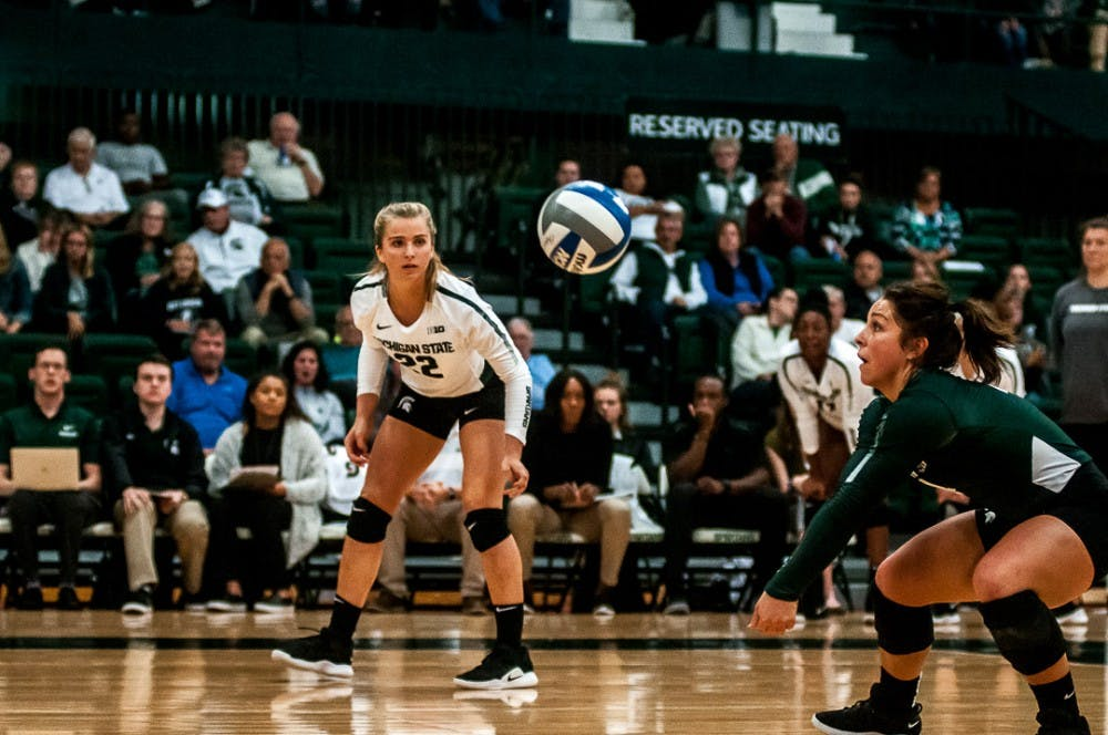 <p>Sophomore libero Jayme Cox (4) goes in for a dig during the game against Rutgers on Sept. 29, 2018 at Jenison Fieldhouse. &nbsp;&nbsp;The Spartans beat the Scarlet Knights, 3-1. &nbsp;</p>