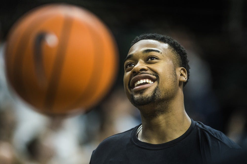 Sophomore forward Nick Ward (44) smiles while warming up before the game against Notre Dame on Nov. 30, 2017 at Breslin Center. The Spartans took down the Fighting Irish, 81-63.
