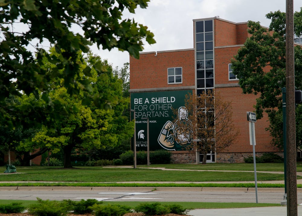 """<p>Reminders to wear masks and practice good hygiene are sprinkled around campus to """"shield"""" fellow spartans from COVID-19. The university has announced that it will require vaccinations going into the fall semester.&nbsp;</p>"""