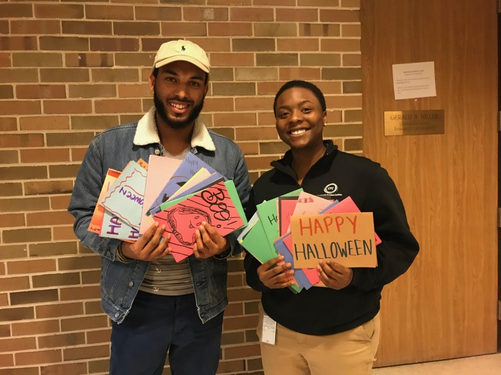 Tyler Logan and Yamani Vinson, holding some of the cards they have received in their Halloween card drive. Photo courtesy of Logan and Vinson.