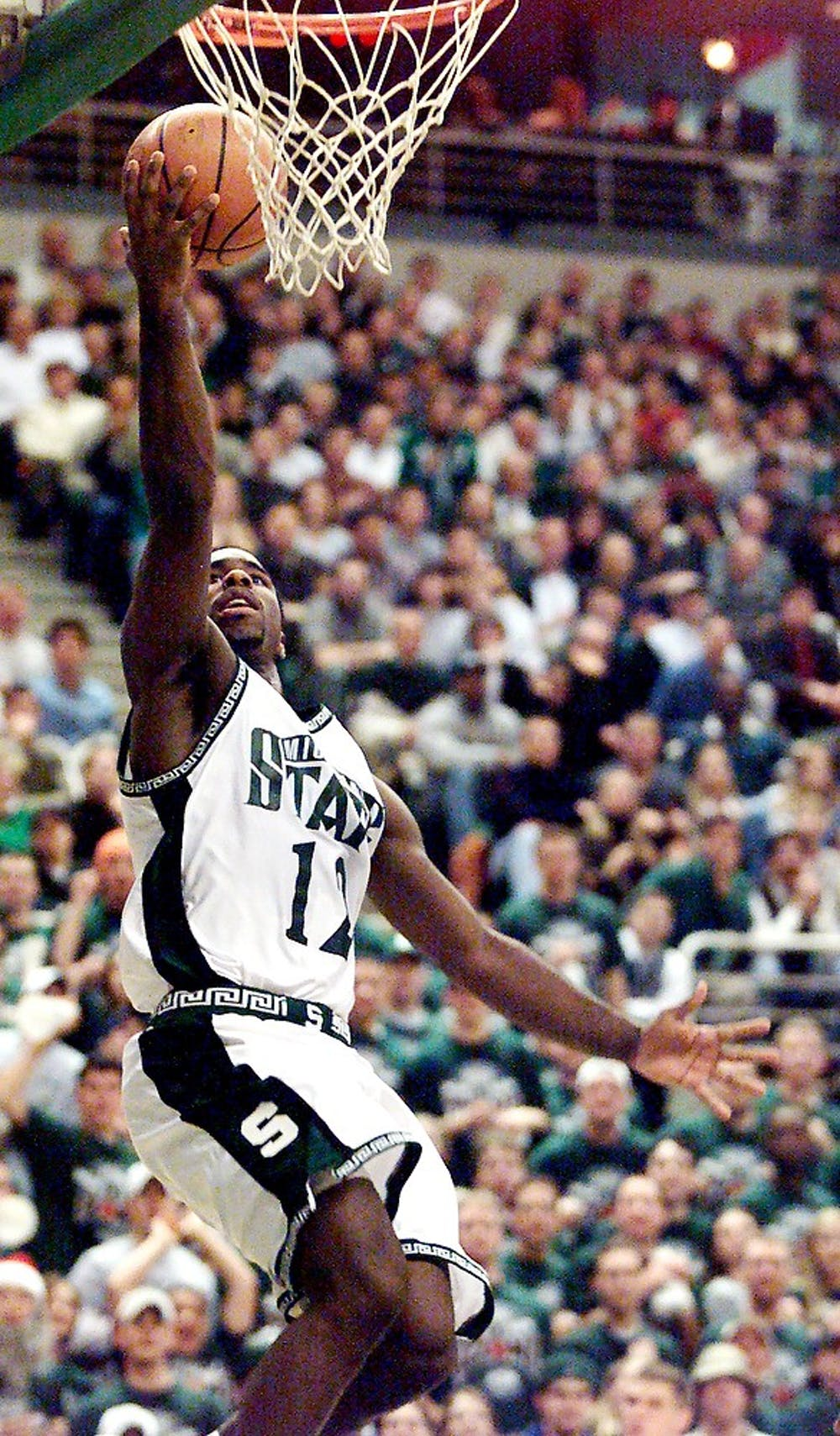<p>Then-senior guard Mateen Cleaves goes up for a shot against Indiana Tuesday at the Breslin Center. The Spartans won, 77-71 in overtime, giving Tom Izzo his 100th win as MSU head coach.Photo courtesy of MSU Athletics by Cory Morse</p>