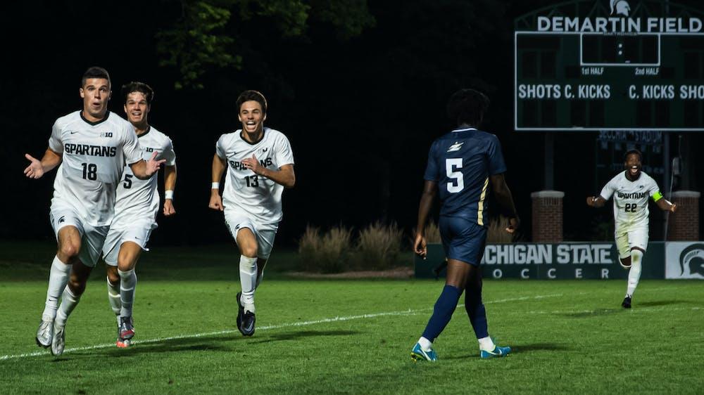 Graduate Student midfielder Michael Miller pulls the 'MJ shrug', following his goal on Aug. 30, 2021.
