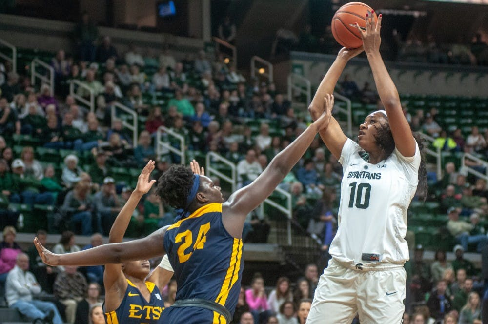 Sophomore forward Syndey Cooks (10) shoots the ball against East Tennessee State's forward Anajae Stephney (24) during the game against East Tennessee State on Nov. 11, 2018 at Breslin Center. The Spartans lead the Buccaneers at halftime, 32-29.