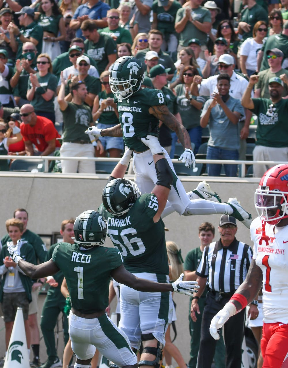 <p>Celebrations ensued as Nailor scores the final touchdown of the game, bringing Michigan State to 42-14 against the Youngstown State Penguins on September 11, 2021. </p>