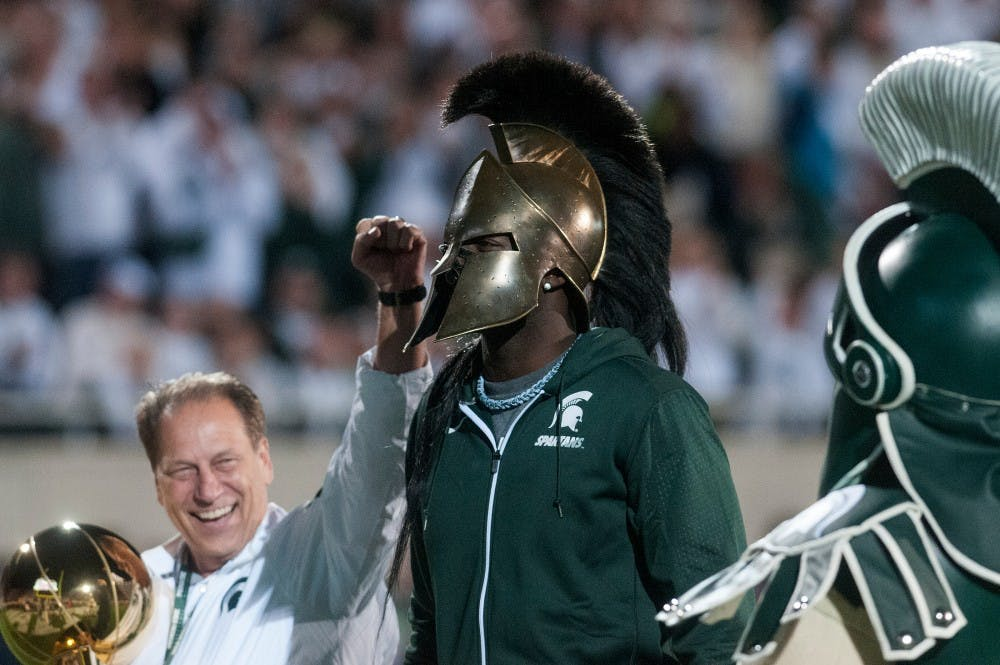 <p>MSU basketball head coach Tom Izzo, former Spartan and current Golden State Warrior forward Draymond Green and Sparty cheer during the game against Oregon on Sept. 12, 2015, at Spartan Stadium. Green was recognized for his recent donation to the Spartan basketball program. The Spartans defeated the Ducks, 31-28. Kennedy Thatch/ The State News</p>