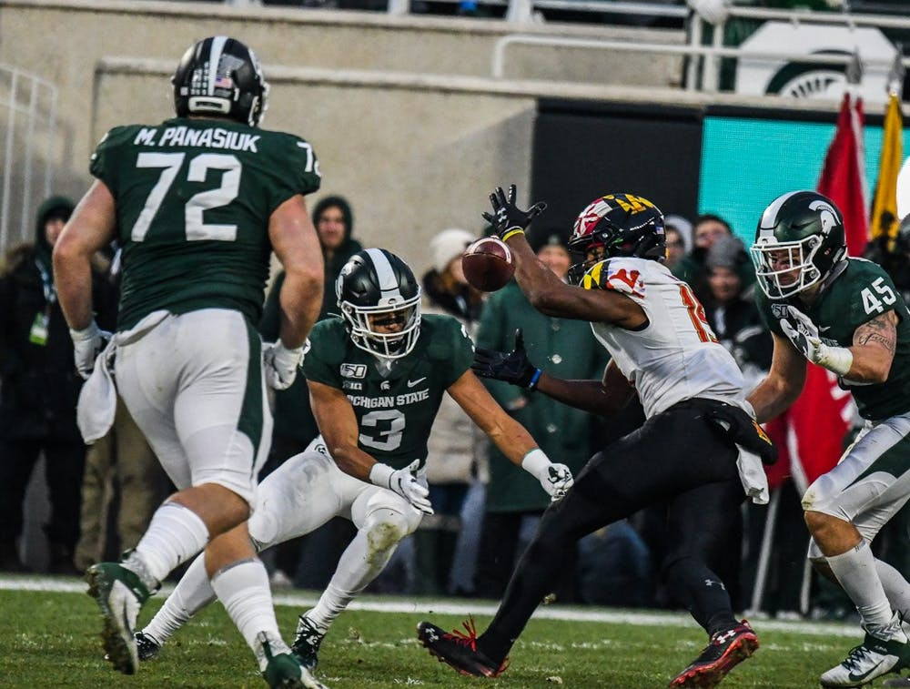 S[partans and Terrapins fight for the ball during the game on Nov. 30, 2019 at Spartan Stadium. The Spartans lead 13-7 against the Terrapins at halftime.