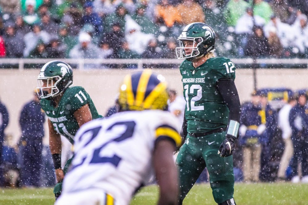 Redshirt freshman quarterback Rocky Lombardi (12) stands behind center during the game against Michigan at Spartan Stadium Oct. 20. The Wolverines defeated the Spartans, 21-7.