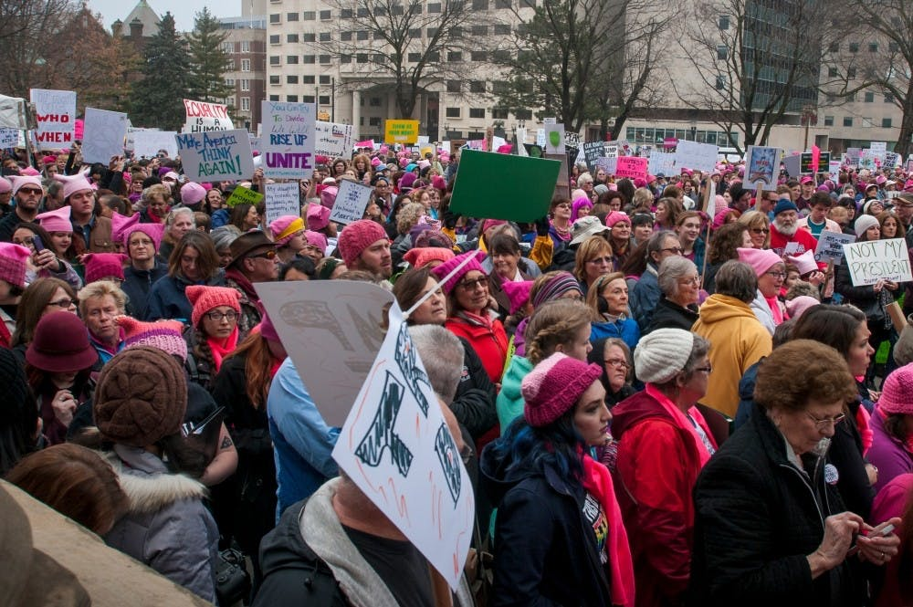 Protesters gather outside of the capitol to listen to speeches during the Women's March on Lansing on Jan. 21, 2017 at the Capital Building in Lansing. Activists gathered and expressed their opinions through peaceful demonstration.