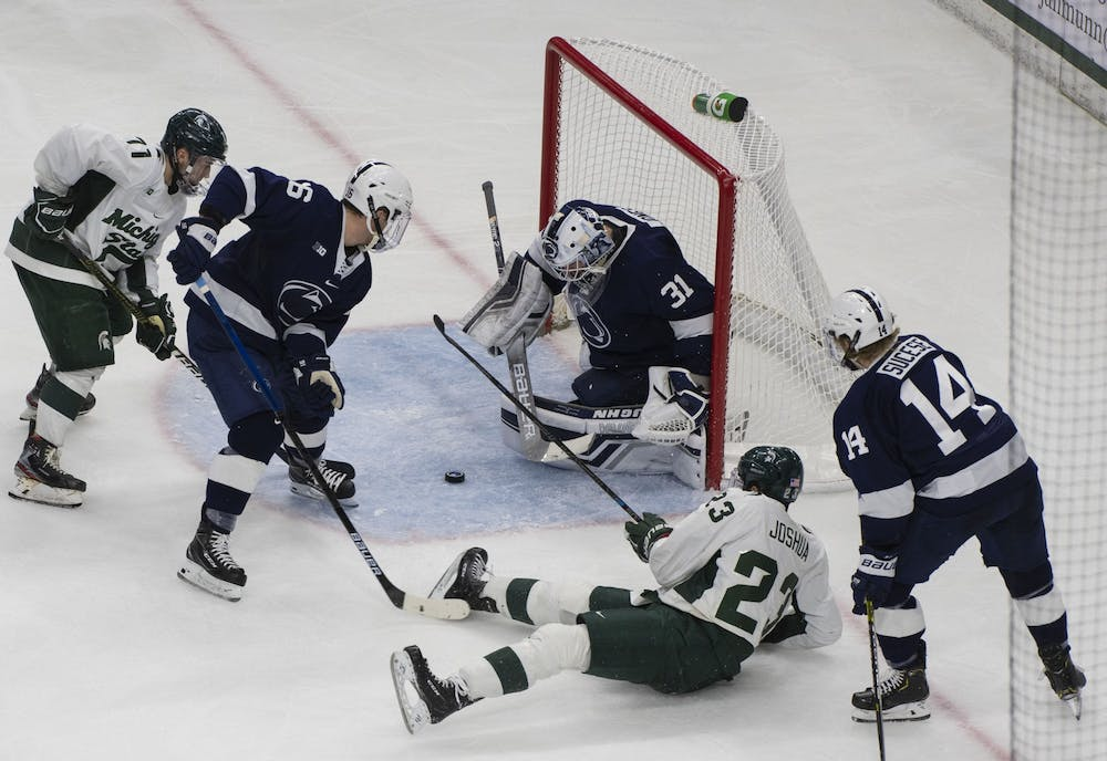 <p>The Spartans fight to get a goal in the third period, with Penn State&#x27;s goaltender Peyton Jones guarding it. MSU fell to Penn State 2-1 on Jan. 25, 2020.</p>