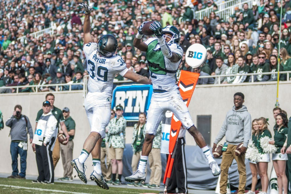 Sophomore wide receiver Justin Layne (2) receives a touchdown pass during the Green and White Spring Game on April 1, 2017 at Spartan Stadium. The White team defeated the Green team, 33-23.