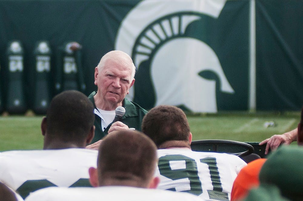 """<p>Former <span class=""""caps"""">MSU</span> football head coach from 1983 to 1994, George Perles, talks to the football team before the start of practice Aug. 27, 2013, at the practice field outside Duffy Daugherty Football Building. </p>"""