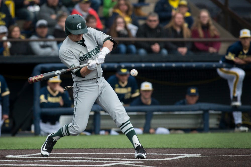 Freshman infielder Marty Bechina (2) swings at the ball during the game against Michigan on April 29, 2016 at Ray Fisher Stadium at Wilpon Baseball Complex in Ann Arbor, Mich. The Spartans were defeated by the Wolverines, 4-3.