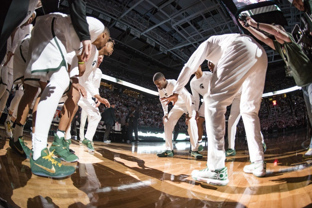 The Spartans huddle before the men's basketball game against the University of Michigan on Jan. 29, 2017 at Breslin Center. The Spartans defeated the Wolverines, 70-62.
