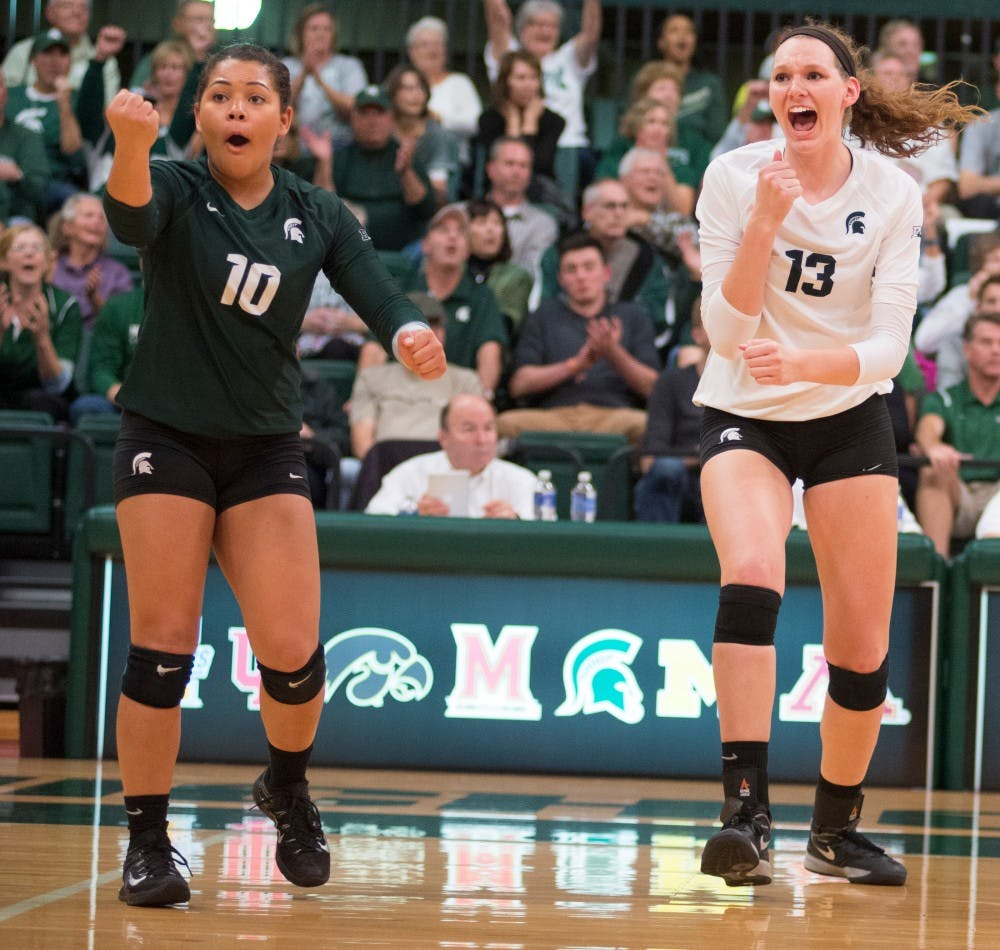 <p>Left to right, sophomore libero Abby Monson and sophomore middle back Brooke Kranda celebrate after a kill during the volleyball game against Ohio State on Oct. 21, 2015 at Jenison Field House. The Spartans defeated Ohio State, 3-0.</p>