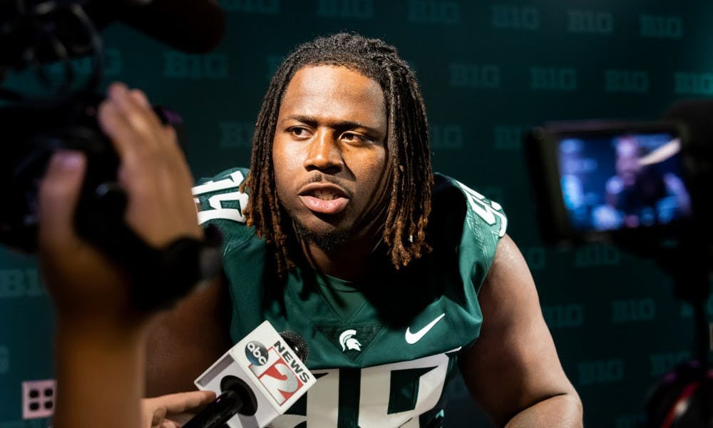 <p>Senior defensive tackle Raequan Williams speaks to the press during Michigan State's Football Media Day at Spartan Stadium on Aug. 5, 2019. </p>