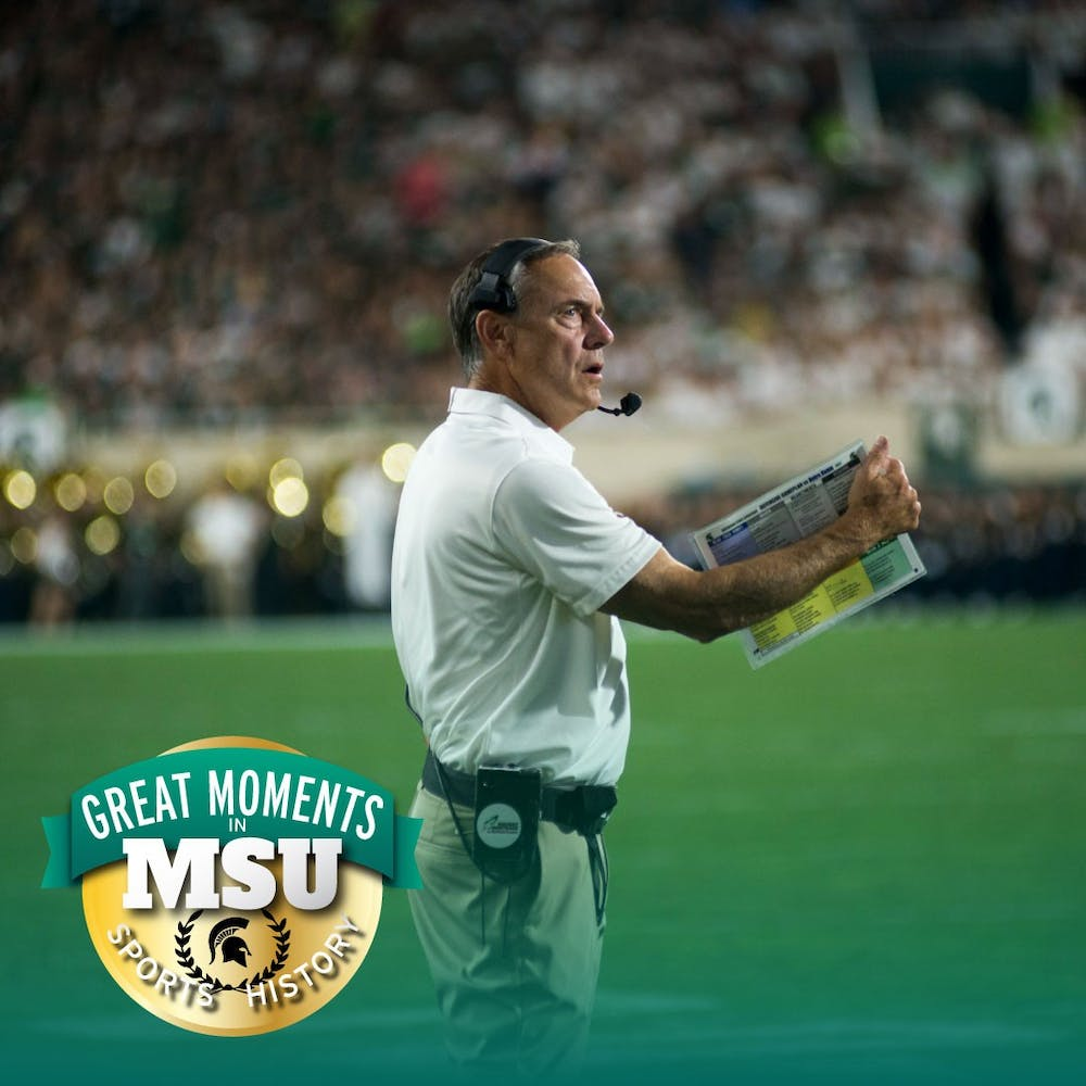 Head Coach Mark Dantonio stares in disbelief at a touchdown call in the end zone during the game against Notre Dame on Sept. 23, at Spartan Stadium. The call was reviewed and confirmed as called on the field. Photo by Matt Schmucker. Design by Daena Faustino.